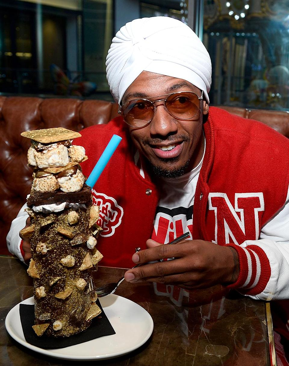 """<p>Nick Cannon is probably counting this as a """"cheat day."""" The multi-hyphenate indulged in the brand new """"Insane Campfire Spiked S'mores Coffee Milkshake"""" at Sugar Factory American Brasserie in Las Vegas. Anyone else hungry? (Photo: Bryan Steffy/Getty Images for Sugar Factory American Brasserie) </p>"""