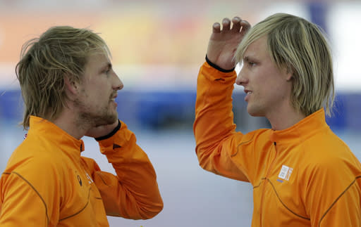 Twin brothers from the Netherlands, gold medallist Michel Mulder, left, and bronze medallist Ronald speak after the men's 500-meter speedskating race at the Adler Arena Skating Center at the 2014 Winter Olympics, Monday, Feb. 10, 2014, in Sochi, Russia. (AP Photo/Matt Dunham)