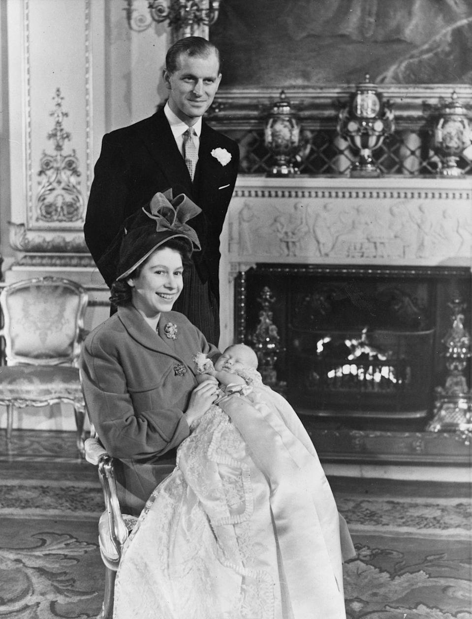<p>Prince Charles was born November 14, and the happy new parents had him christened that December at Buckingham Palace — in a version of the same gown that William, Harry, George, and Charlotte all wore!</p>