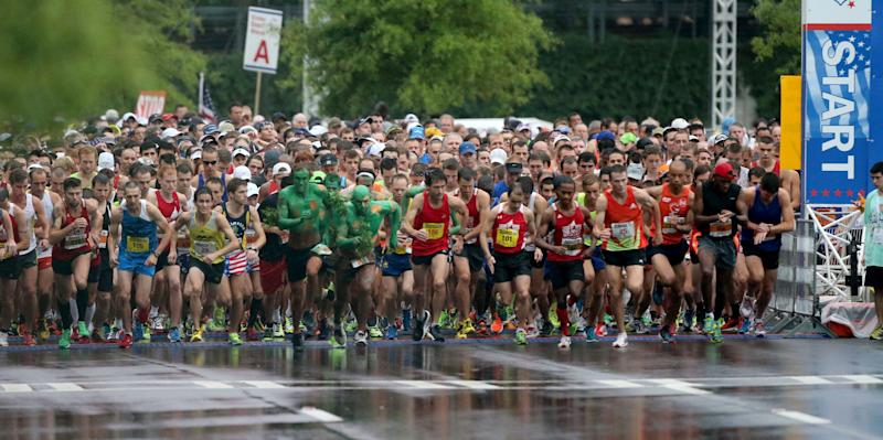 July 4, 2013 - Atlanta, Ga: Runners start of the 44th running of the AJC Peachtree Road Race at Lenox Square Thursday morning in Atlanta, Ga., July 4, 2013. The 10K race is a Fourth of July tradition in Atlanta that's billed as the largest road race in the U.S. (AP Photo/Atlanta Journal-Constitution, Jason Getz) MARIETTA DAILY OUT; GWINNETT DAILY POST OUT; LOCAL TV OUT; WXIA-TV OUT; WGCL-TV OUT