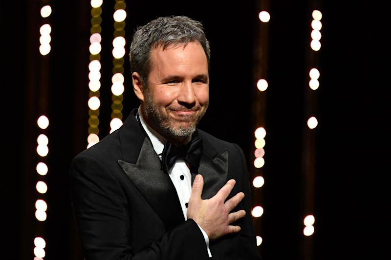 Canadian director and member of the Feature Film Jury Denis Villeneuve gestures as he arrives on stage on May 8, 2018 during the opening ceremony of the 71st edition of the Cannes Film Festival in Cannes, southern France. (Photo by Alberto PIZZOLI / AFP) (Photo credit should read ALBERTO PIZZOLI/AFP via Getty Images)