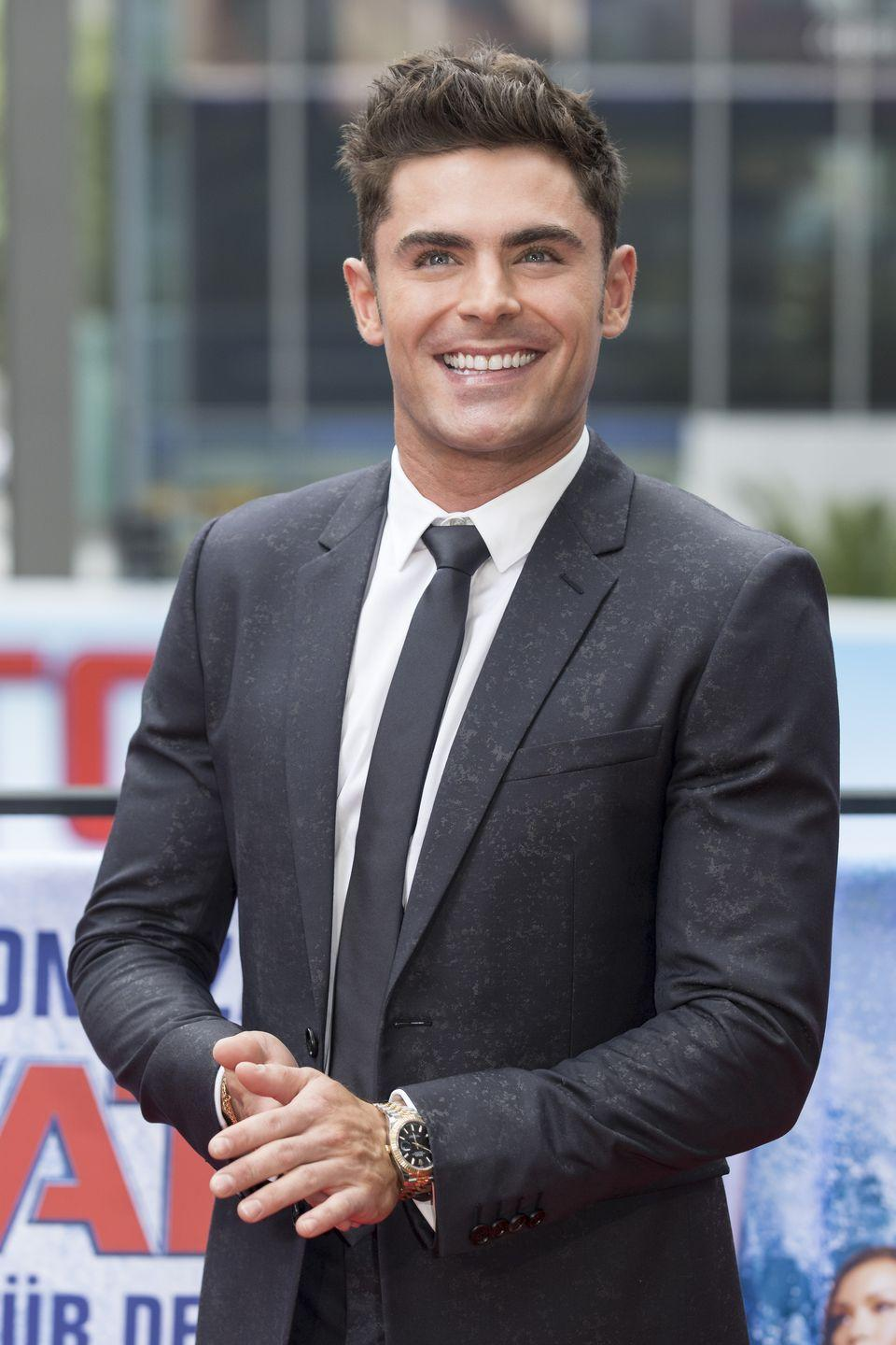 "<p>Sans beard, Efron looks like he could break out into ""We're All in This Together"" at any moment. We prefer the beard, <del>Troy</del> Zac. </p>"