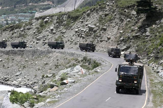 Indian army trucks move along a highway leading to Ladakh on Wednesday