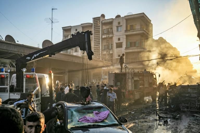 Three simultaneous bombings killed at least six civilians in Syria's Qamishli, a war monitor says (AFP Photo/Delil souleiman)