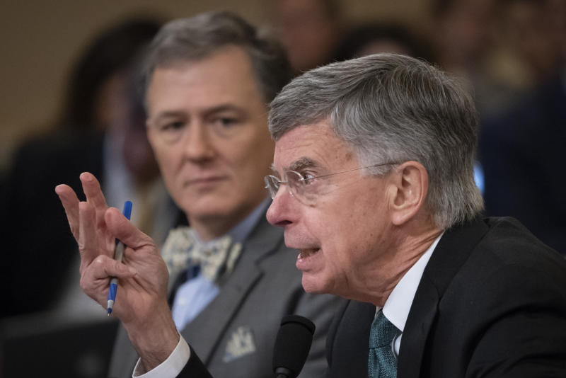 The top U.S. diplomat in Ukraine William Taylo and career Foreign Service officer George Kent testify before the House Intelligence Committee on Capitol Hill in Washington, Wednesday, Nov. 13, 2019/ (AP Photo/J. Scott Applewhite)