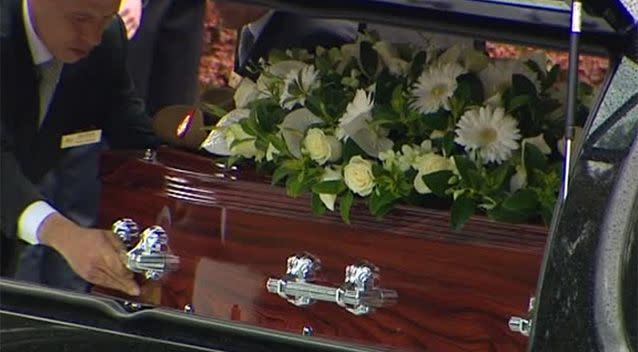 Hundreds attended the funeral, where Stuart's coffin was decorated with white flowers. Photo: 7News