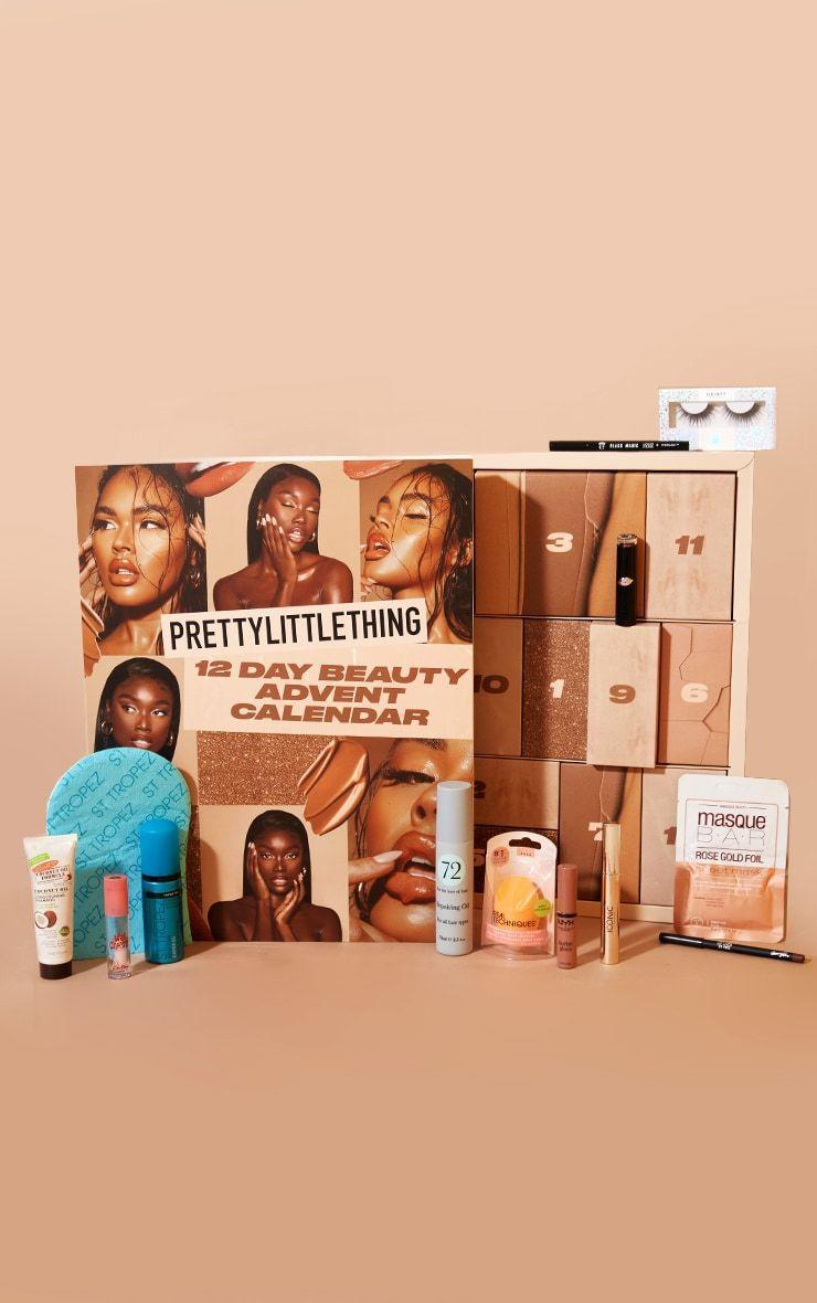 """<p><strong>PRETTYLITTLETHING</strong></p><p>prettylittlething.us</p><p><strong>$34.00</strong></p><p><a href=""""https://go.redirectingat.com?id=74968X1596630&url=https%3A%2F%2Fwww.prettylittlething.us%2Fprettylittlething-12-day-beauty-advent-calendar-worth-108-50.html&sref=https%3A%2F%2Fwww.townandcountrymag.com%2Fstyle%2Fbeauty-products%2Fnews%2Fg2919%2Fbeauty-advent-calendars%2F"""" rel=""""nofollow noopener"""" target=""""_blank"""" data-ylk=""""slk:Shop Now"""" class=""""link rapid-noclick-resp"""">Shop Now</a></p><p>Need a little less commitment? Go for the 12 days of Christmas with 12 days of beauty goodies (worth almost $150) like a MasqueBar Sheet Mask, Eyeko Black Magic Liquid Eyeliner, and St Tropez Mousse & Mitt. </p>"""