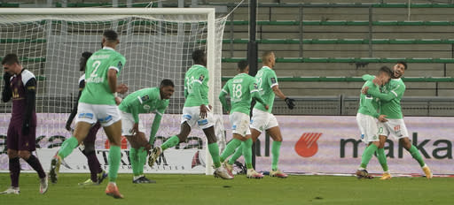 Saint-Etienne players celebrate after Romain Hamouma scored the opening goal during the French League One soccer match between Saint-Etienne and Paris Saint-Germain at the Geoffroy Guichard stadium, in Saint-Etienne, central France, Wednesday, Jan. 6, 2021. (AP Photo/Laurent Cipriani)