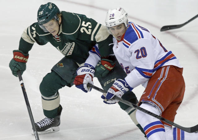 Minnesota Wild's Jonas Brodin, left, of Sweden, and New York Rangers' Chris Kreider get their arms hooked in the first period of an NHL hockey game on Thursday, March 13, 2014, in St. Paul, Minn. (AP Photo/Jim Mone)