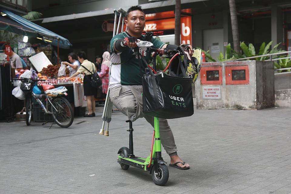 Saire Adnan had his right leg amputated in 2013 but that did not stop him from signing up as an Uber Eats delivery partner in July this year. (PHOTO: Dhany Osman / Yahoo News Singapore)