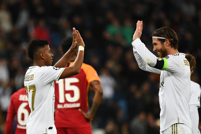 Real Madrid's Brazilian forward Rodrygo (L) celebrates with Real Madrid's Spanish defender Sergio Ramos after scoring during the UEFA Champions League Group A football match between Real Madrid and Galatasaray at the Santiago Bernabeu stadium in Madrid, on November 6, 2019. (Photo by GABRIEL BOUYS / AFP) (Photo by GABRIEL BOUYS/AFP via Getty Images)