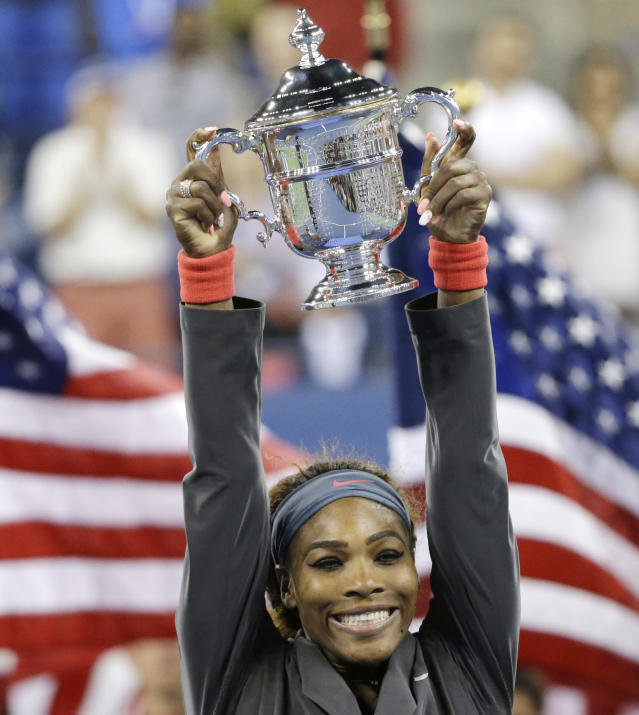 Serena Williams holds up the championship trophy after defeating Victoria Azarenka, of Belarus, during the women's singles final of the 2013 U.S. Open tennis tournament, Sunday, Sept. 8, 2013, in New York. (AP Photo/David Goldman)