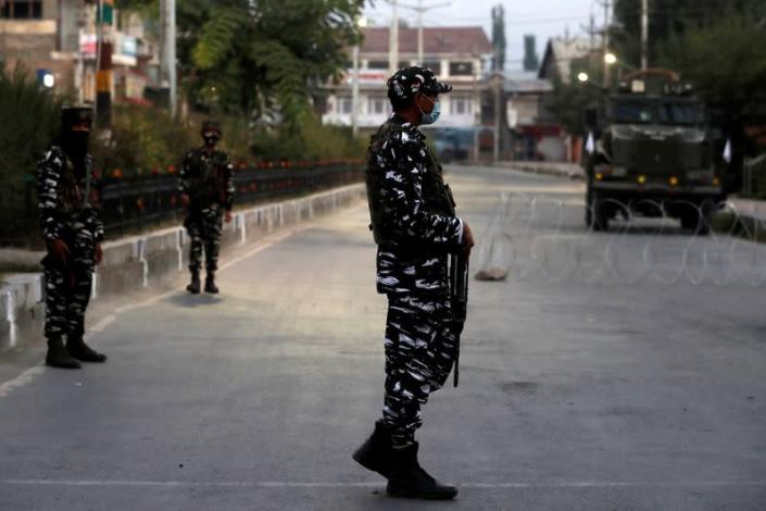 Indian security force personnel stand guard near the residence of Syed Ali Shah Geelani after his death in Srinagar
