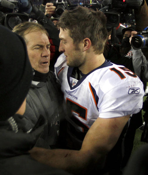FILE- In this Jan. 14, 2012, file photo, then-Denver Broncos quarterback Tim Tebow, right, hugs New England Patriots head coach Bill Belichick following an NFL divisional playoff football game in Foxborough, Mass. Tebow is joining the New England Patriots, according to a report by ESPN on Monday, June 10, 2013. The high-profile quarterback who spent one season mostly on the sidelines with the New York Jets is expected to attend the start of the Patriots three-day minicamp on Tuesday. (AP Photo/Charles Krupa, File)