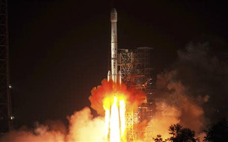 The Long March-3B rocket carrying the Chang'e-3 lunar probe blasts off from the launch pad at Xichang Satellite Launch Center