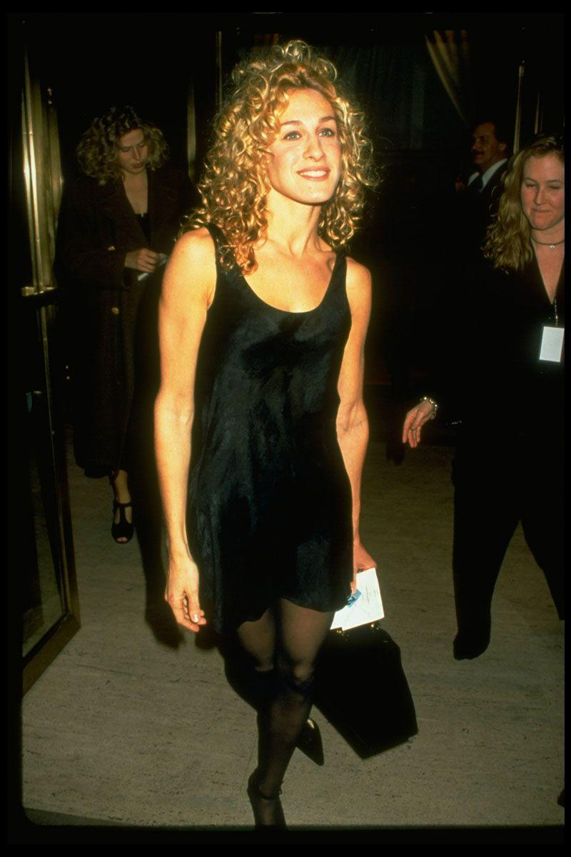 <p>Pre-Carrie Bradshaw, Sarah Jessica Parker flexed her style skills in a short black slip dress and sheer tights. </p>
