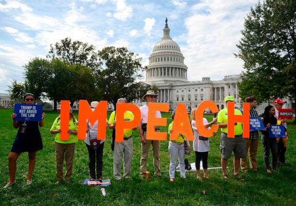 PHOTO: Demonstrators hold up letters reading 'impeach' in front of the Capitol building during the 'People's Rally for Impeachment,' Sept. 26, 2019. (Andrew Caballero-Reynolds/AFP/Getty Images)