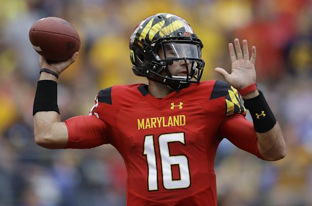 Maryland quarterback C.J. Brown throws to a receiver in the first half of an NCAA college football game against West Virginia in Baltimore, Saturday, Sept. 21, 2013. (AP Photo/Patrick Semansky)
