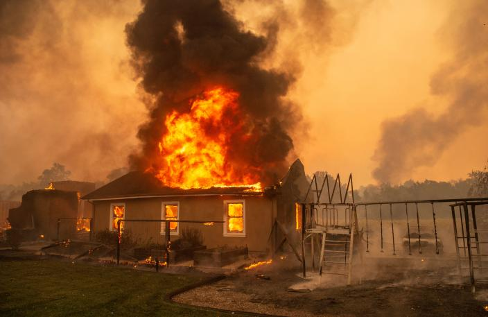 A home burns at a vineyard during the Kincade fire near Geyserville, California on October 24. (Photo by JOSH EDELSON/AFP via Getty Images)
