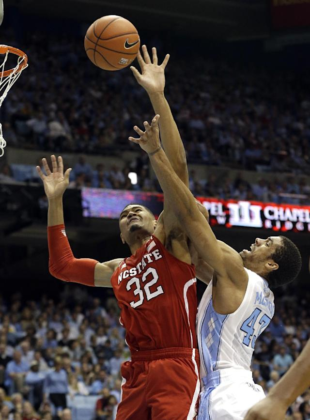 North Carolina's James Michael McAdoo (43) shoots as North Carolina State's Kyle Washington (32) defends during the first half of an NCAA college basketball game in Chapel Hill, N.C., Saturday, Feb. 1, 2014. (AP Photo/Gerry Broome)