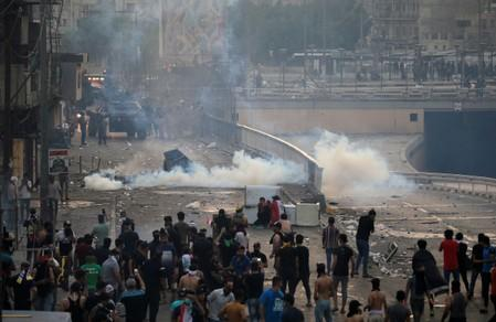 Iraq declares curfews as gunfights rage and protests spread nationwide