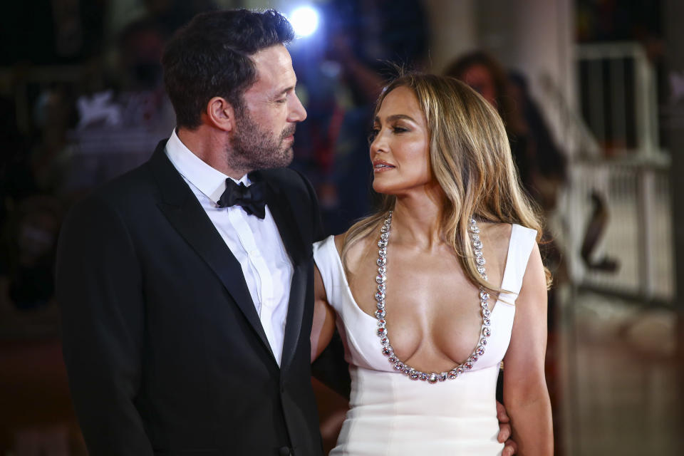 Jennifer Lopez, right, and Ben Affleck pose for photographers upon arrival at the premiere of the film 'The Last Duel' during the 78th edition of the Venice Film Festival in Venice, Italy, Friday, Sept. 10, 2021. (Photo by Joel C Ryan/Invision/AP)