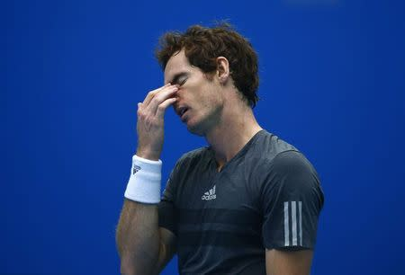 Andy Murray of Britain reacts after missing a shot during the men's singles semi-final match against Novak Djokovic of Serbia at the China Open tennis tournament in Beijing October 4, 2014. REUTERS/Petar Kujundzic