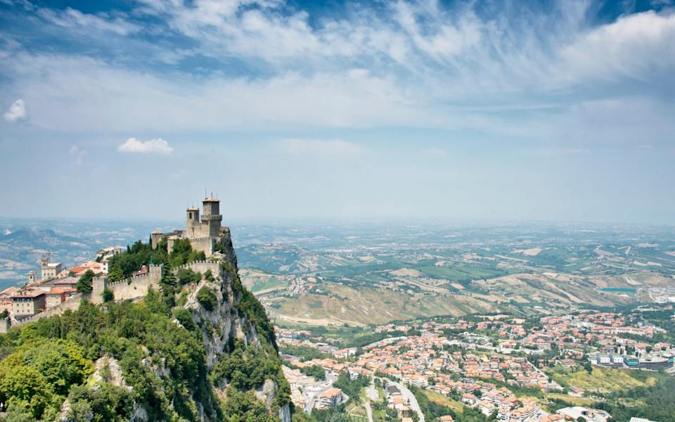 San Marino is dominated by a fortress on top of a rocky crag -  Paul Biris / Moment RF