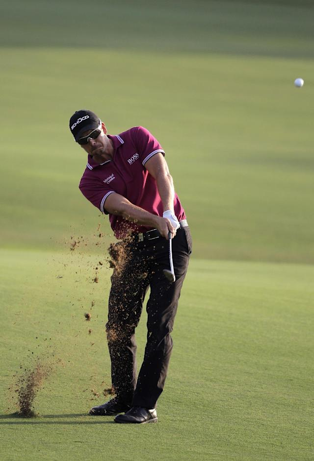 Henrik Stenson from Sweden plays a ball on the 18th hole during the 2nd round of DP World Golf Championship in Dubai, United Arab Emirates, Friday, Nov. 15, 2013. (AP Photo/Kamran Jebreili)
