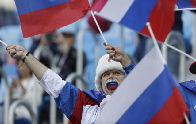 Fan waves a flag prior the group A match between Russia and Egypt at the 2018 soccer World Cup in the St. Petersburg stadium in St. Petersburg, Russia, Tuesday, June 19, 2018. (AP Photo/Gregorio Borgia)