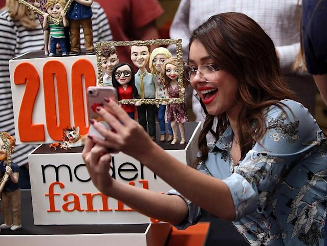 <p>Members of the <em>Modern Family</em> cast was having their cake and eating it too as they celebrated their 200th episode at Fox Studios on Wednesday. Hyland made sure to snap a photo of the impressive confection, which had all the main characters in edible form! (Photo: David Livingston/Getty Images) </p>