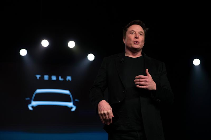 Tesla CEO Elon Musk speaks before unveiling the Model Y at the company's design studio Thursday, March 14, 2019, in Hawthorne, Calif. (AP Photo/Jae C. Hong)