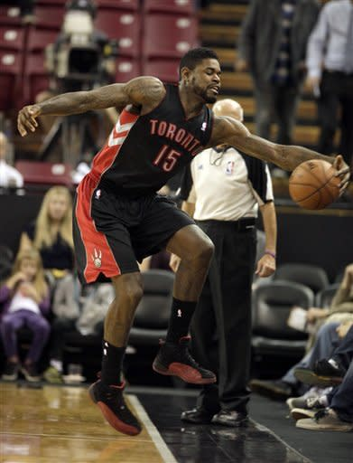 Toronto Raptors forward Amir Johnson tries to save the ball from going out of bounds during the first quarter of an NBA basketball game against the Sacramento Kings in Sacramento, Calif., Wednesday, Dec. 5, 2012.(AP Photo/Rich Pedroncelli)