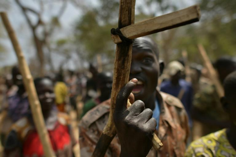 A soldier gestures with his wooden rifle at a UN-run programme to reconcile government troops with their former rebel enemies -- a key component of South Sudan's peace process (AFP Photo/TONY KARUMBA)