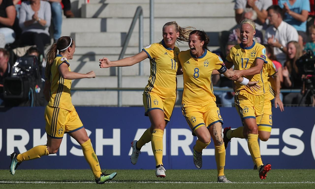 Lotta Schelin (No8) celebrates with her Sweden team-mates after scoring the opening goal.