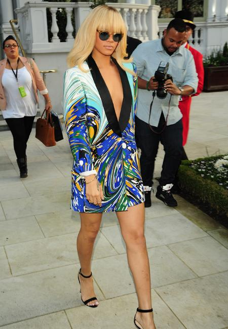 Celebrity fashion: Rihanna appeared nearly naked in a Stella McCartney marble-print jacket-dress. Her learn legs were all on show but all attention is on that plunging neckline. RiRi is a brave girl!