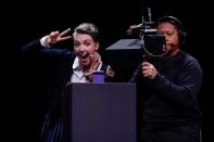 Rebecca Hirst of Samsung Electronics gestures for a selfie with the Z Flip foldable smartphone during Samsung Galaxy Unpacked 2020 in San Francisco