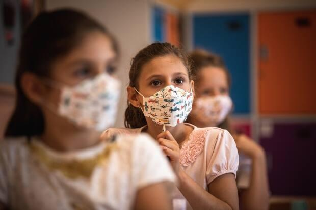 Children under the age of 12 aren't currently eligible for the COVID-19 vaccine, so the pilot project aims to help provide additional protection to them. (Andrej Isakovic/AFP via Getty Images - image credit)