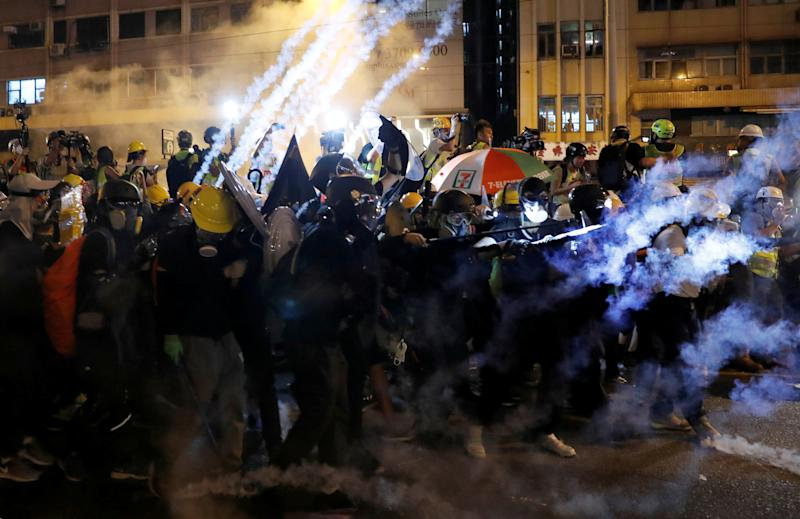 An anti-extradition demonstrators have tear gas fired at them as they clash with riot police, after a march of to call for democratic reforms, in Hong Kong, China July 21, 2019. (Photo: Tyrone Siu/Reuters)