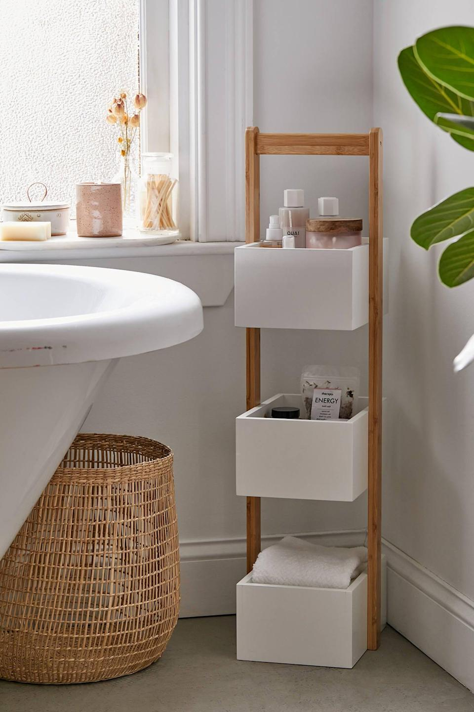 "<p>This <a href=""https://www.popsugar.com/buy/3-Tier-Bamboo-Bath-Storage-Caddy-540307?p_name=3-Tier%20Bamboo%20Bath%20Storage%20Caddy&retailer=urbanoutfitters.com&pid=540307&price=129&evar1=casa%3Aus&evar9=47251564&evar98=https%3A%2F%2Fwww.popsugar.com%2Fhome%2Fphoto-gallery%2F47251564%2Fimage%2F47251612%2F3-Tier-Bamboo-Bath-Storage-Caddy&list1=cleaning%2Corganization%2Cspring%20cleaning%2Csmall%20space%20living%2Cbathrooms%2Chome%20organization&prop13=mobile&pdata=1"" class=""link rapid-noclick-resp"" rel=""nofollow noopener"" target=""_blank"" data-ylk=""slk:3-Tier Bamboo Bath Storage Caddy"">3-Tier Bamboo Bath Storage Caddy</a> ($129) is great for your daily products.</p>"