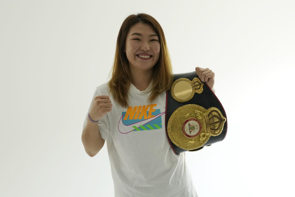 WBA woman super featherweight champion Choi Hyunmi poses for photos during an interview in Seoul, South Korea, on June 21, 2021. South Korea's only boxing world champion is Choi, a North Korean defector who fled her authoritarian homeland as a 13-year-old girl with her family in 2003. (AP Photo/Ahn Young-joon)
