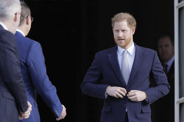 Britain's Prince Harry arrives at the gardens at Buckingham Palace in London, Thursday, Jan. 16, 2020. Prince Harry, the Duke of Sussex will host the Rugby League World Cup 2021 draw at Buckingham Palace, prior to the draw, The Duke met with representatives from all 21 nations taking part in the tournament, as well as watching children from a local school play rugby league in the Buckingham Palace gardens. (AP Photo/Kirsty Wigglesworth)