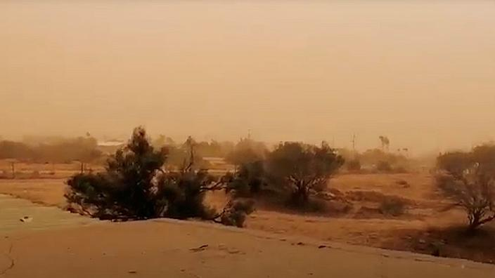 Strong winds kicked up dust storms ahead of the rain