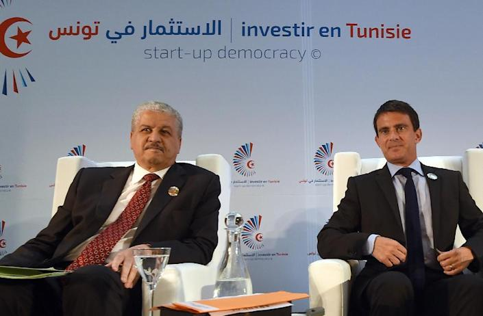 "Algerian Prime Minister Abdelmalek Sellal (L) and French Prime Minister Manuel Valls attend the opening session of the ""Invest in Tunisia, Start-up Democracy"" international conference on September 8, 2014 in Tunis (AFP Photo/Fethi Belaid)"