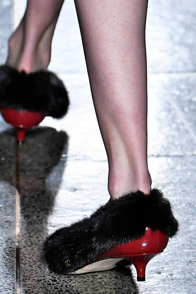 <p>Kane also debuted fur-lined patent-leather red heels at his London Fashion Week show. (Photo: Getty Images) </p>