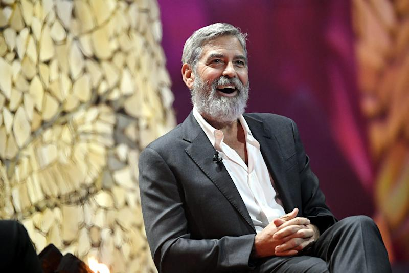George Clooney laughs during the Nordic Business Forum business seminar in Helsinki, Finland on October 10, 2019. (Photo by Heikki Saukkomaa/Lehtikuva/AFP via Getty Images)