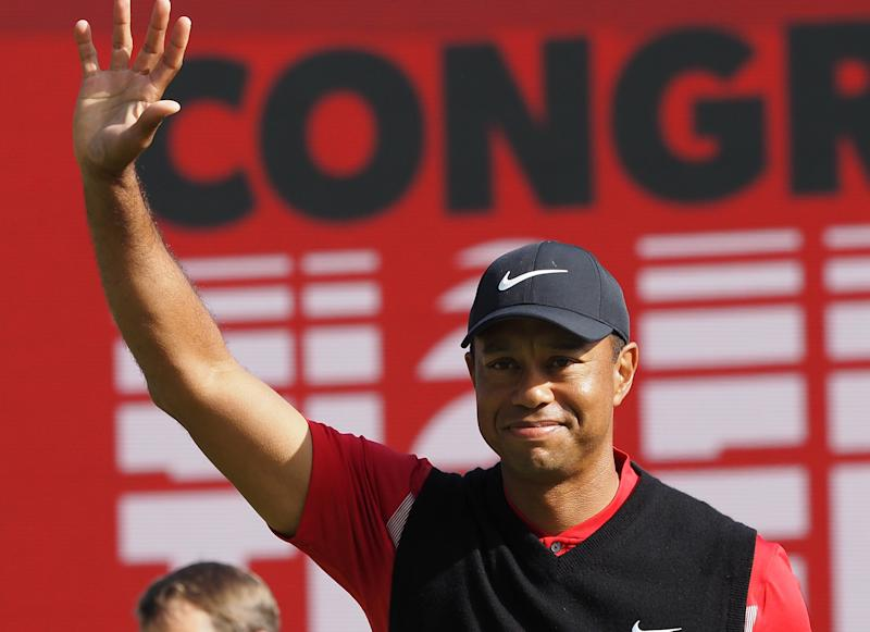 Tiger Woods of the US waves on the 18th hole green after finishing the final round of the PGA ZOZO Championship golf tournament at the Narashino Country Club in Inzai, Chiba prefecture on October 28, 2019. (Photo by TOSHIFUMI KITAMURA / AFP) (Photo by TOSHIFUMI KITAMURA/AFP via Getty Images)