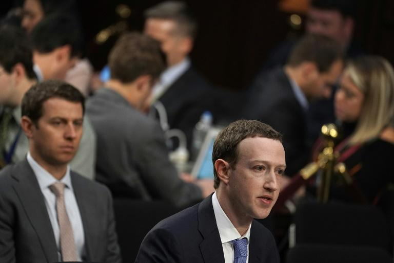 Facebook, whose CEO Mark Zuckerberg is seen at a Senate hearing this year, is among the Silicon Valley giants feeling pressure from lawmakers and regulators (AFP Photo/ALEX WONG)