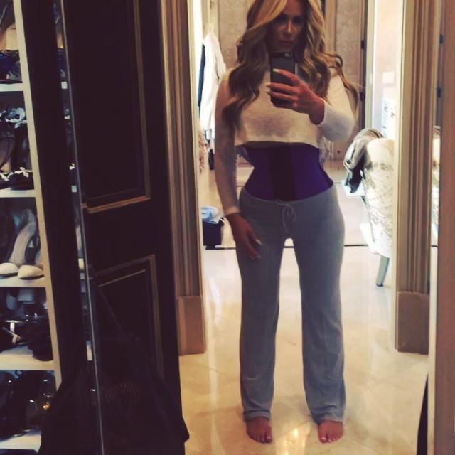 """""""Who doesn't love a waist trainer?"""" Those are the words you'll hear Kim Zolciak say on Instagram as she promotes one of the latest celebrity trends, waist-training. ET caught up with the former <em>Real Housewives of Atlanta</em> star at her home to find out more about how she waist trains, and she fired back at those who are claiming her pics are Photoshopped. """"There's a lot of haters, and a lot of people said I Photoshop my picture so I finally just did a video, because you can't Photoshop video, to finally shut people up,"""" Zolciak said. """"It frustrates me."""" """"Sooooo I made a video since most of you think I Photoshop my pics! I don't cause I don't need to!"""" she wrote on her Instagram. """"I have horrible posture (carrying the twins did me in) and it really helps that too at least for me. I recommend the waist trainer because it works so well for me and I like to share with you guys what products I love since there are so many out there!"""" The 37-year-old mother of six also used Instagram to share that she lost four inches off her waist, crediting waist-training for helping her. Although she said she didn't start out as a paid spokesperson for the brand, she is receiving compensation now. <strong> PHOTOS: Kim Zolciak Shows Off Her 'Cinderella' Waist </strong> Just two days ago, she included a promo code for her followers to receive 15 percent off after captioning a pic of her in a waist-trainer, """"Lost 4 inches from wearing my waist trainer from @nowaistclique."""" Zolciak told ET that she has been waist-training for about three and a half months, revealing that she wears her waist-trainer for five hours a day – a practice she admitted makes her sweat """"profusely."""" And yet, she isn't afraid of the hidden dangers associated with waist-training. """"I have not gotten a varicose vein, have not had acid reflux, not had any issues whatsoever,"""" she said. While she may not have any medical complications, <em>Yahoo! Health</em> warns that wearing the undergarment can result in serious r"""
