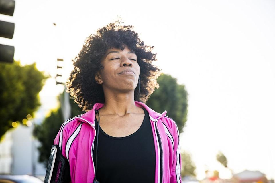 """Pausing to take a few deep breaths throughout the day can improve both your mood and your overall health. A 2017 study published in the journal <em>Breathe</em> revealed that deep breathing can <a href=""""https://www.ncbi.nlm.nih.gov/pmc/articles/PMC5709795/"""" rel=""""nofollow noopener"""" target=""""_blank"""" data-ylk=""""slk:reduce heart rate variability"""" class=""""link rapid-noclick-resp"""">reduce heart rate variability</a> as well as <a href=""""https://onlinelibrary.wiley.com/doi/abs/10.1111/psyp.13091"""" rel=""""nofollow noopener"""" target=""""_blank"""" data-ylk=""""slk:increase feelings of calmness"""" class=""""link rapid-noclick-resp"""">increase feelings of calmness</a> and overall wellbeing."""